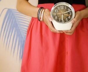 holding clock 81845740