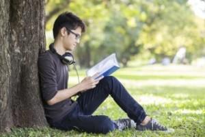 reading under tree