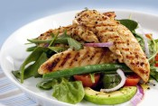 Salad of grilled chicken tenderloins with avocado, tomatoes, red onion, green beans, spinach and arugula.  Delicious healthy eating.