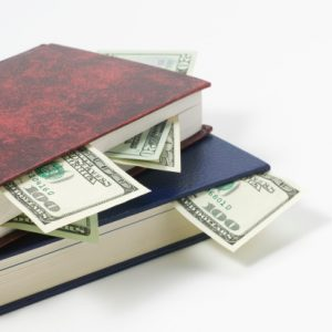 Stack of books and money